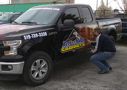 Installation of vehicle decals in Windsor, Ontario