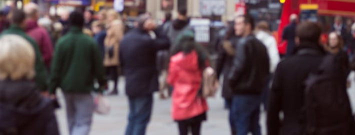 People representing customer segments walking on a busy street