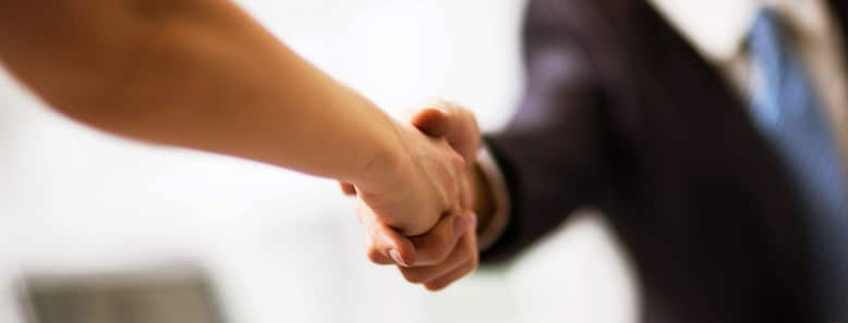 employer shaking employes hand as a reward